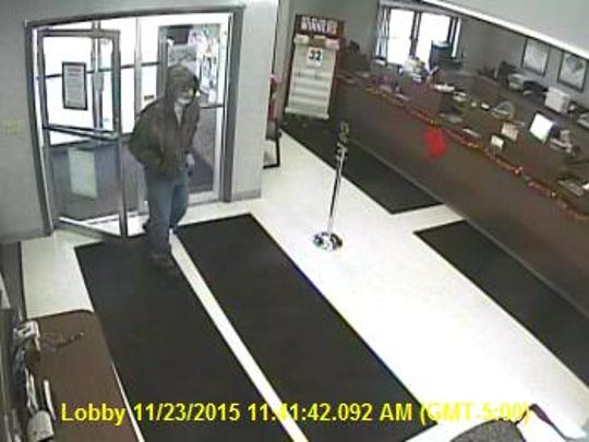 Police released this surveillance image of bandit who held up First Merchants Bank in Eaton late Monday morning.