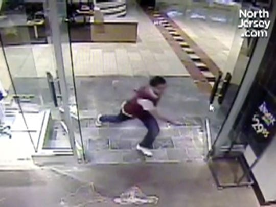 Surveillance cameras captured 20-year old Richard Shoop stalking around the Westfield Garden State Plaza on November 4, 2013, carrying a large weapon and terrifying shoppers and workers.