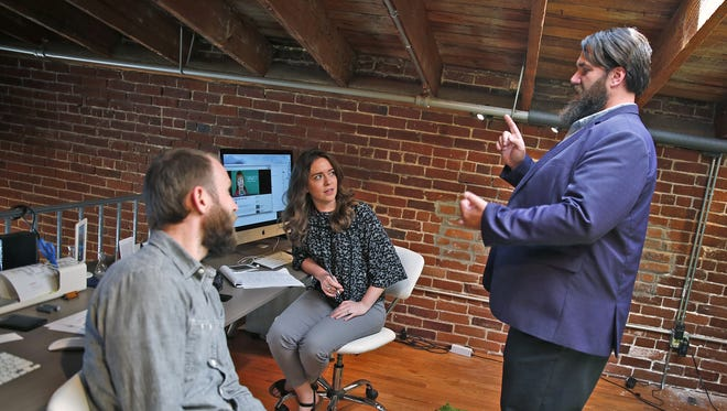 From left, marketing employees Clint Culberson and Hannah Marr speak with Branch Manager Michael Partin at Parker Mortgage Team, a group in the Finance of America Mortgage company, at the company's Noblesville offices. Parker Mortgage Team is one of the Top Workplaces in Central Indiana for 2017.