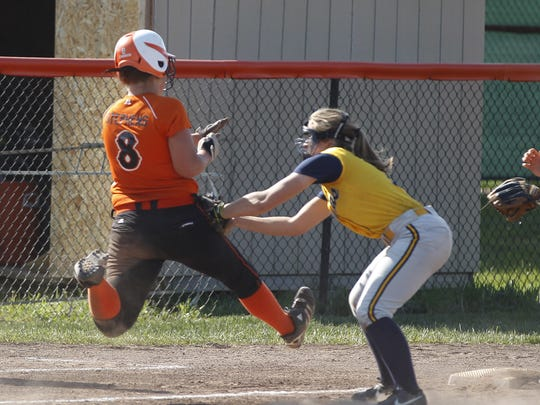 Ryle High School's Katelyn Stephens is tagged out at third base.
