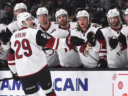 Arizona Coyotes left wing Brendan Perlini (29) is greeted