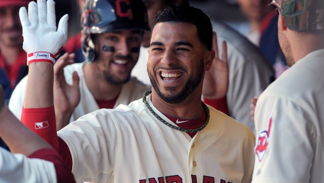 Mike Aviles celebrates in the dugout after his three-run homer.