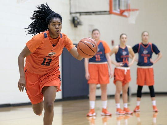 UTEP senior Sparkle Taylor dribbles up court during