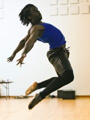 "Emmanuel Freeman of the Minnesota Dance Ensemble rehearses his dance Sunday, April 17, for the show, ""In These Shoes"" which will be at the Paramount Theatre."
