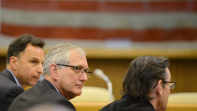 Portland Portland Mayor Charlie Hales (center) speaks during a hearing on Senate Bill 941, which would expand background checks for private gun sales, on Wednesday, at the Oregon State Capitol.