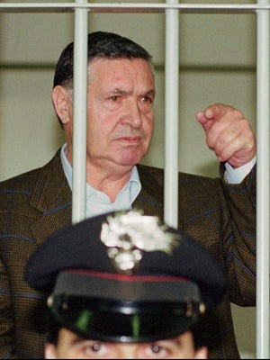 "In this April 29, 1993 file photo, Mafia ""boss of bosses"" Salvatore ""Toto"" Riina, is seen behind bars, during a trial in Rome."
