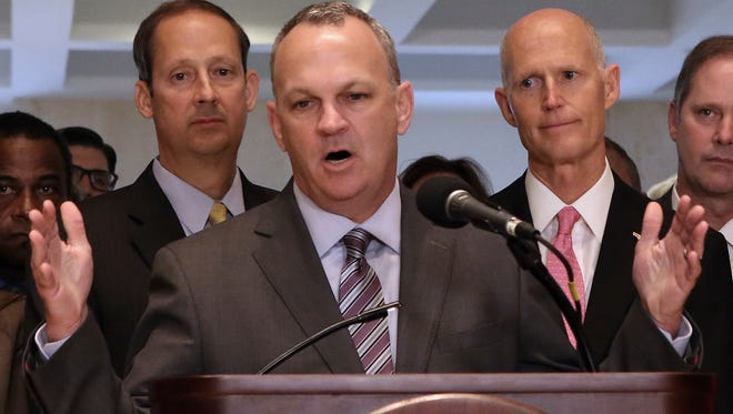 Houses speaker Richard Corcoran (center) addresses legislators and media at the end of the special session as senate president Joe Negron (left) and Gov. Rick Scott look on Friday, June 9, 2017, in Tallahassee.