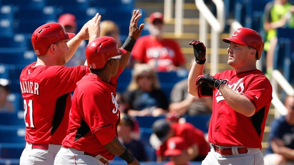 Cincinnati Reds right fielder Jay Bruce (32) celebrates with Todd Frazier (21) and Marlon Byrd (9) after hitting a three-run home run against the Milwaukee Brewers.