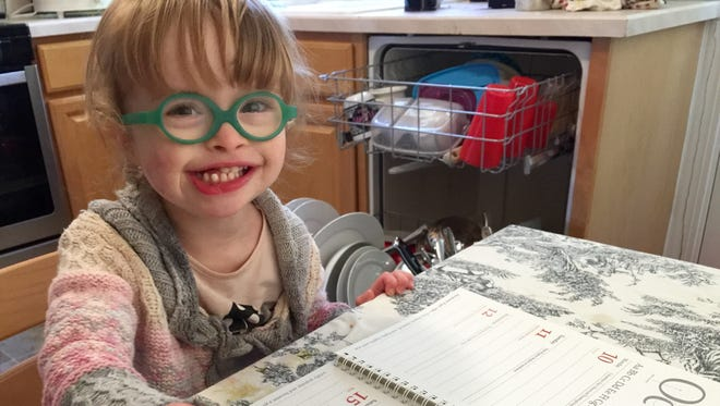 A photo of Evelyn Ingold, 3, will appear in a National Down Syndrome Society video to be shown in September at Times Square in New York.