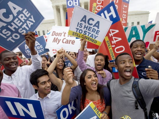 Students cheer Thursday outside the U.S. Supreme Court in Washington, D.C., after the  Affordable Care Act ruling. See story on
