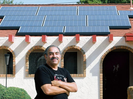 Tony Lewis last week stood outside his Northeast El Paso home, which was recently equipped with a rooftop solar system.