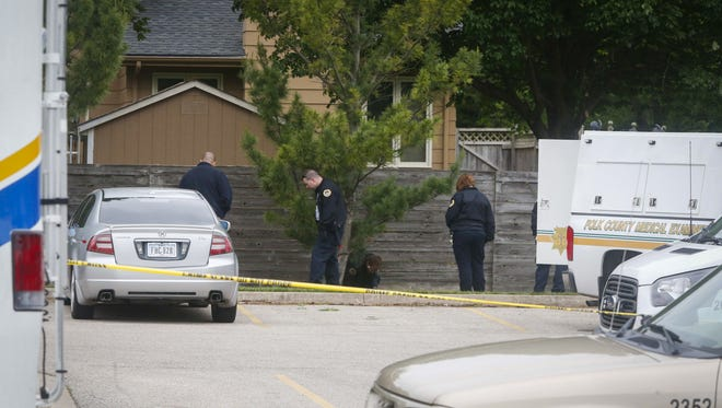 Des Moines police and Polk County officials are still gathering evidence at the scene of a deadly shooting in the parking lot of Zion Lutheran Church in Des Moines on Sunday, May 21, 2017.