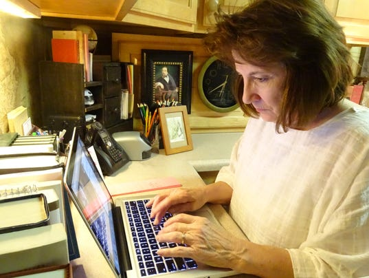 1- Typing at her desk