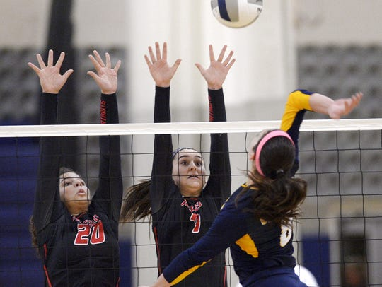 Penfield's Sarah Green, left, and Beth Lawatsch try
