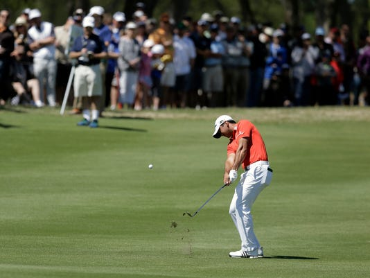 Jason Day, of Australia, hits a shot on the first hole during round-robin play against Paul Casey at the Dell Match Play Championship golf tournament at Austin County Club, Friday, March 25, 2016, in Austin, Texas. (AP Photo/Eric Gay)