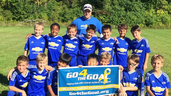 Coach Todd Pheiffer (top) and Northville Rush '07B Nero team raised money to the Go 4 The Goal orgnaniation.
