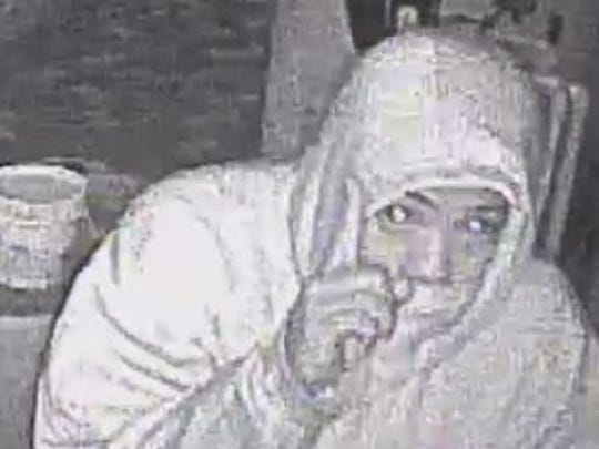 This surveillance image shows a suspect believed to have helped hold a family of seven hostage for several hours.