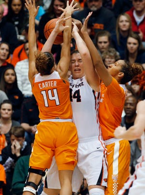 Oregon State's Ruth Hamblin, center, is double-teamed by Tennessee's Andraya Carter, left, and Mercedes Russell  on Dec. 19, 2015.