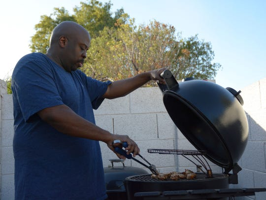 Weldon Johnson prepares grilled chicken wings on Jan.