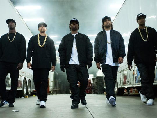 """This photo provided by Universal Pictures shows, Aldis Hodge, from left, as MC Ren, Neil Brown, Jr. as DJ Yella, Jason Mitchell as Eazy-E, O'Shea Jackson, Jr. as Ice Cube and Corey Hawkins as Dr. Dre, in the film, """"Straight Outta Compton."""""""