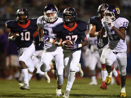 Belton-Honea Path's Semaj Groves (27) carries against