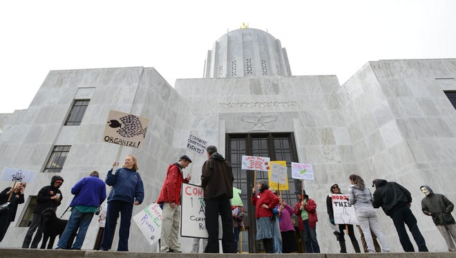 Protesters rally against banning Oregon counties from regulating GMOs during a special legislative session in 2013.