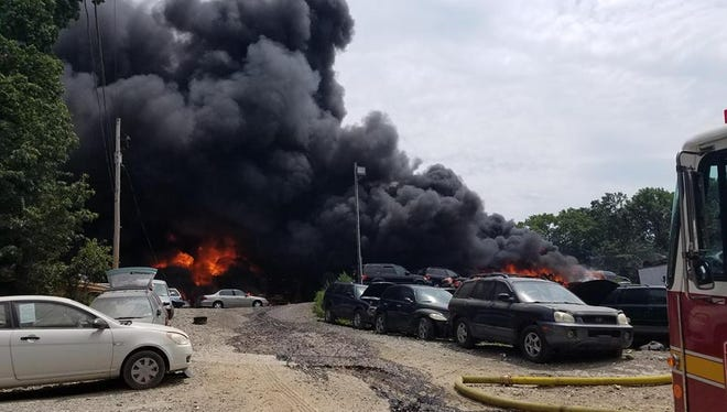 Heavy black smoke could be seen for miles from the fire at a salvage yard in Windsor Township.