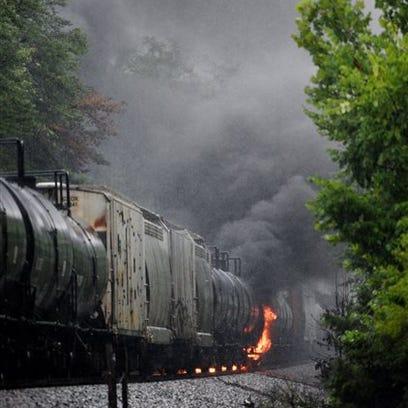 Smoke rises from a CSX train following the derailment