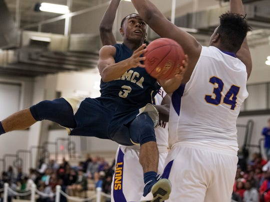 East Memorial's Lee Crawford (3) goes hard to the goal against Evangel's Kory Gaines (34) in the AISA Class A Boys State Championship game in Montgomery, Ala., on Saturday February 3, 2018.