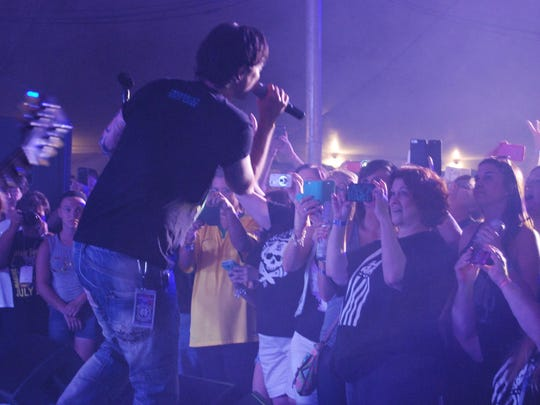 Fans take photos of Jeff Gutt as he performs Friday at the Marine City Music Festival Beach Party.