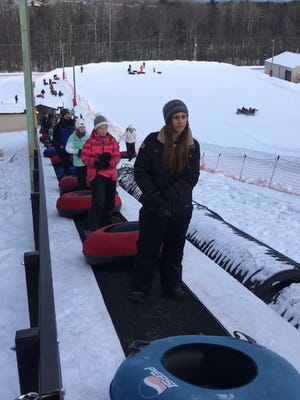 Snow tubing enthusiasts ride the Magic Carpet lift up the tubing hill at Winter Park in Kewaunee. The new stand-up lift is considered one of the reasons Winter Park, which is now closed for the season, set a new attendance record in 2017-18.