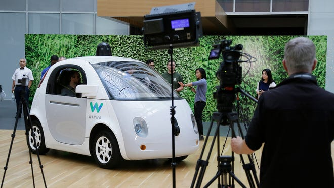 In this Dec. 13, 2016, file photo, the Waymo driverless car is displayed during a Google event in San Francisco. California regulators have taken an important step to clear the road for everyday people to get self-driving cars.