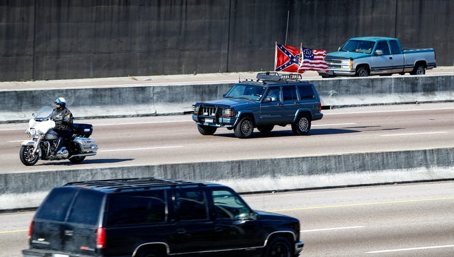 """January 06, 2018 - Police escort leads a convoy of protesters on I-240 as they demonstrate against the recent removal of Confederate monuments. The """"rolling rally,"""" organized by the Facebook page Confederate 901, is expected to begin at noon as protesters drive to Health Sciences Park and Fourth Bluff Park, Confederate battle flags flying, from staging points in the suburbs and in Mississippi and Arkansas."""