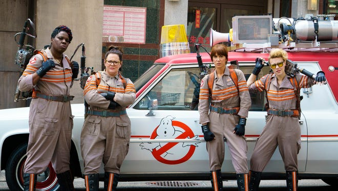 """From left, Leslie Jones, Melissa McCarthy, Kristen Wiig and Kate McKinnon appear in a scene from the film, """"Ghostbusters."""""""