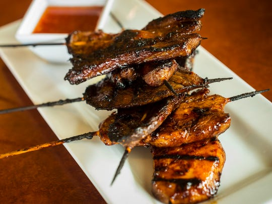 FILIPINO BARBEQUE SKEWER PLATTER: Two chicken, steak and pork skewers grilled, served with a Filipino dipping sauce, at Esperanza Restaurante located at 180 Battery Street in Burlington, Vermont. Seen on Tuesday, March 28, 2017.