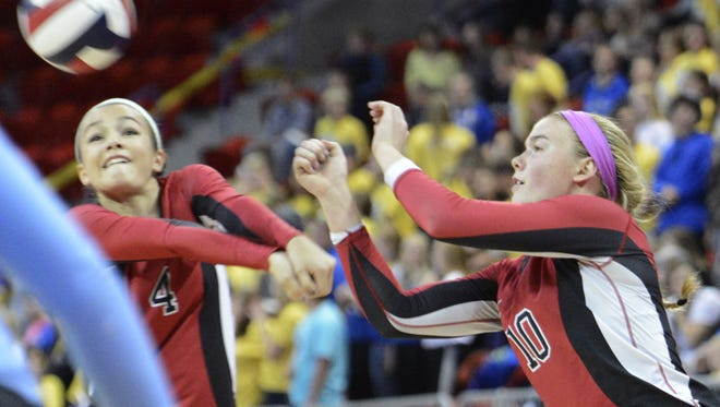 Newman Catholic's Rylie Vaughn, left, and Mariah Whalen are two key returning players for Cardinals team that has won three straight WIAA Division 4 state titles