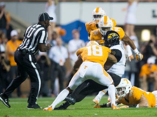 Tennessee defensive back Nigel Warrior (18) hits Southern Miss quarterback Keon Howard (2) during the game between Tennessee and Southern Miss at Neyland Stadium in Knoxville, Tennessee, on Saturday, Nov. 4, 2017.