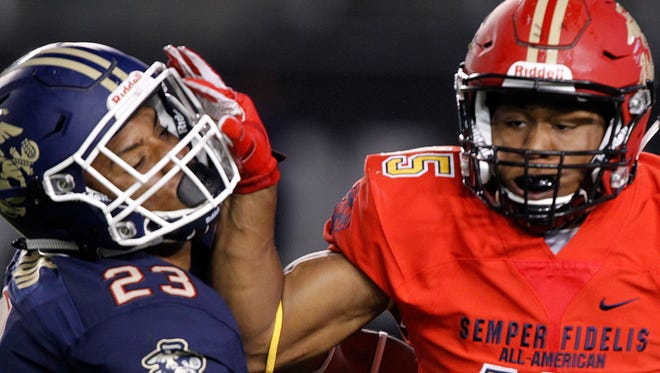 Safety Khaleke Hudson, left, tries to make a tackle during the Semper Fidelis All-American Bowl in Carson, Calif., on Jan. 3, 2016.