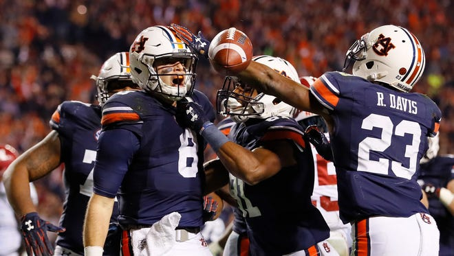 Auburn's Jarrett Stidham celebrates with teammates after rushing for a touchdown against Alabama on Saturday.