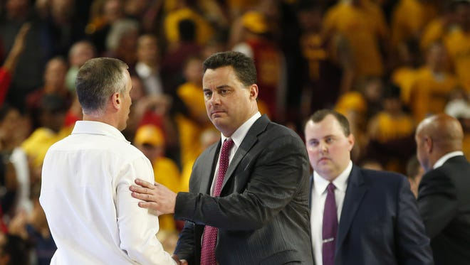 Arizona State Sun Devils head coach Bobby Hurley shakes hands with Arizona Wildcats head coach Sean Miller after losing a men's basketball game at Wells Fargo Arena in Tempe on February 15, 2018. #asu basketball