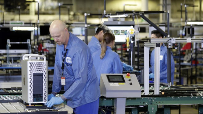 Workers are shown at an Apple manufacturing plant in November 2019 in Austin, Texas. American factories slowed for the third consecutive month in May as they continued to sustain economic damage from the coronavirus pandemic. The Institute for Supply Management, an association of purchasing managers, said Monday, June 1, 2020, that its manufacturing index came in at 43.1 last month after registering 41.5 in April. Anything below 50 signals that U.S. manufacturers are in retreat.