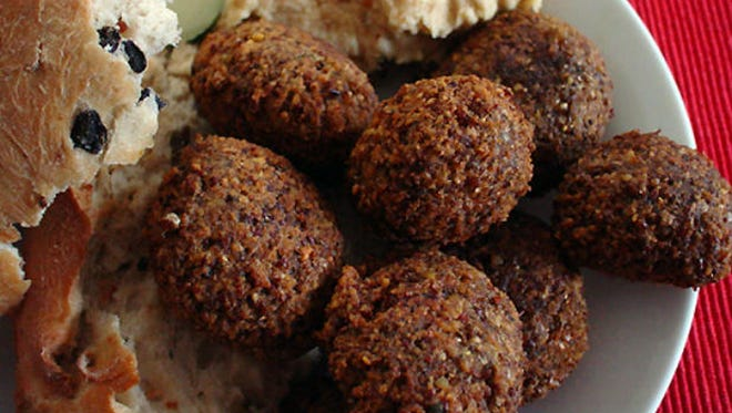 Falafel balls, Middle East: This is a deep-fried, crunchy ball made from ground-up chick peas or fava beans (or sometimes from both). Falafel balls are immensely popular across the world but particularly in the Middle East, where they can be eaten as a snack, as a finger food (often dipped into yogurt or sour cream) or as a full meal with pita, salad and toppings.