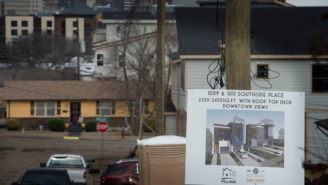 New houses go up along Southside Avenue in a neighborhood that was once built for affordable housing Jan. 18, 2017.