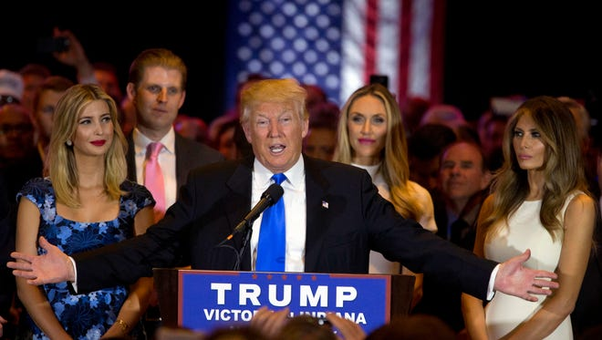 Republican presidential candidate Donald Trump is joined by his wife Melania, right, daughter Ivanka, left, and son Eric, background left, as he speaks during a primary night news conference, Tuesday, May 3, 2016, in New York.