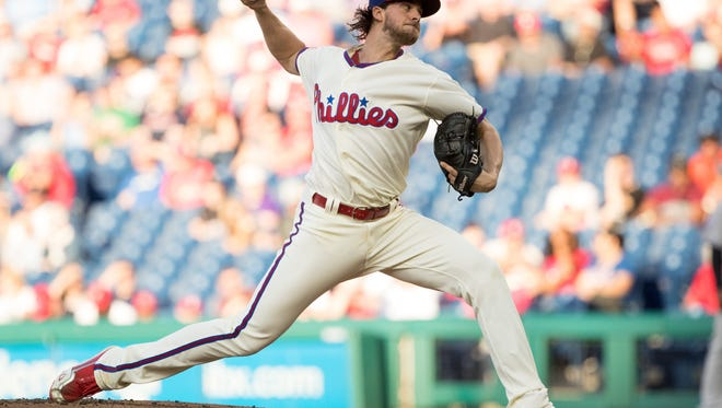 Jun 12, 2018; Philadelphia, PA, USA; Philadelphia Phillies starting pitcher Aaron Nola (27) pitches during the first inning against the Colorado Rockies at Citizens Bank Park. Mandatory Credit: Bill Streicher-USA TODAY Sports