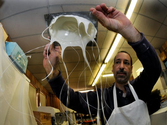 In 2009, Richard Govatos, a chocolate maker since he was 18, molds what looks like white chocolate jelly fish. It's actually a white chocolate Easter baskets. Govatos has been making chocolate in downtown Wilmington since 1894.