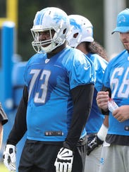 Lions tackle Greg Robinson watches drills during practice