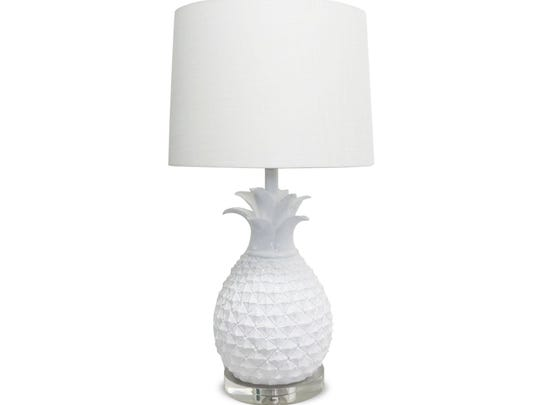 From Overstock.com, a white ceramic pineapple lamp is a chic accessory that brings just a touch of the tropics.