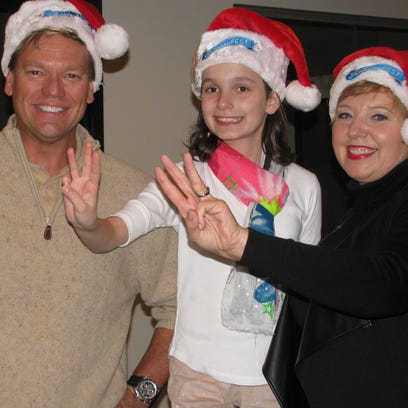 HolidayFest board members Michael Smith and Beverly Jones (right) hope to raise enough money at the annual St. Nicholas Ball for the Make A Wish Foundation of Middle Tennessee to grant wishes to three young people. Jessica Meyer (center) had her wish granted last year.