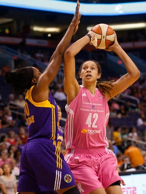 Phoenix Mercury center Brittney Griner looks to shoot around Los Angeles Sparks forward Nneka Ogwumike during the first quarter at US Airways Center on July 29, 2014. Mercury players wore pink for breast health awareness.